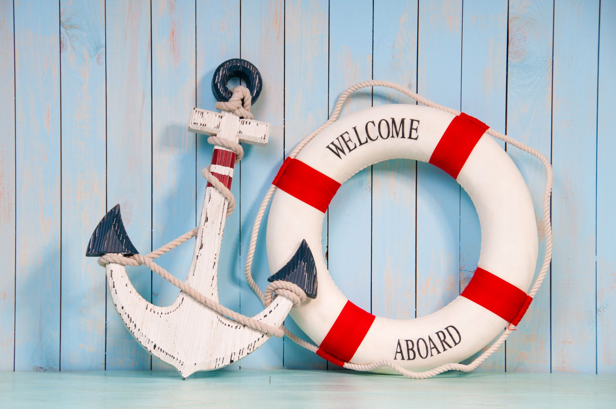 Welcome Aboard life preserver and anchor.
